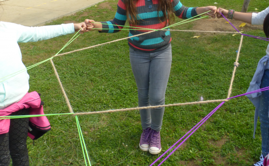 5 pointed String Star, held by students outside on grass